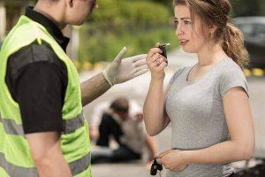 Woman taking a breathalyzer test in Jacksonville FL